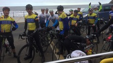 The biking enthusiasts finishing their gruelling 'Tour de Yorkshire' ride at Scarborough