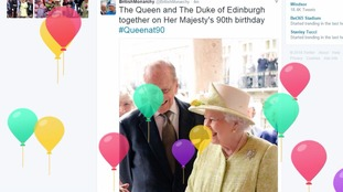 The Queen's Twitter page is decorated with floating balloons