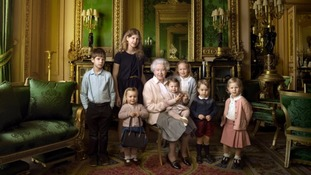 A photograph of the Queen surrounded by her five great-grandchildren and her two youngest grandchildren has been released.
