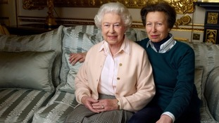 The Queen is pictured sitting on the sofa with her only daughter, Princess Anne.