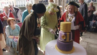 Great British Bake Off winner Nadiya Hussain presents the Queen with her 90th birthday cake