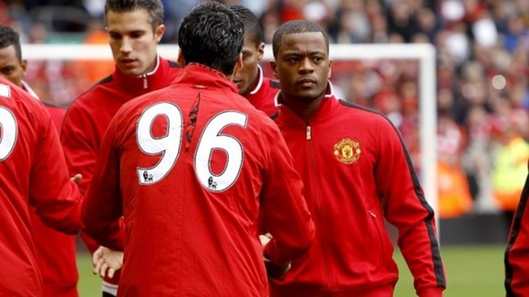 Liverpool's Luis Suarez shook hands with Patrice Evra before kick-off
