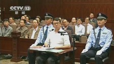 Former police chief Wang speaking during a court hearing in Chengdu