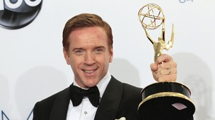 Damian Lewis holds up the award for outstanding lead actor in a drama series
