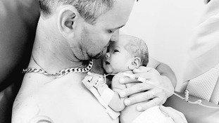 Father cradles newborn daughter after mother tragically dies in childbirth