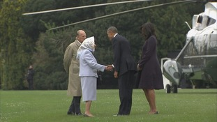 The Queen shakes hands with President Obama.