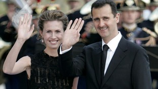 President Bashar al-Assad and his wife Asma arrive for a formal dinner in Paris in 2008