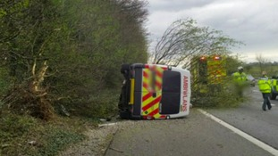 Overturned ambulance on M4