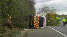 Overturned ambulance on M4
