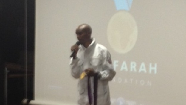 Double Olympic gold medallist Mo Farah talks to students at Feltham Community College today.