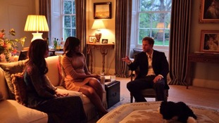 The Duchess of Cambridge and Prince Harry talk with the First Lady before dinner at Kensington Palace