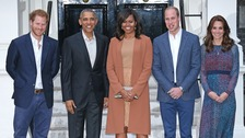 Prince Harry stands with the Duke and Duchess of Cambridge and the Obamas