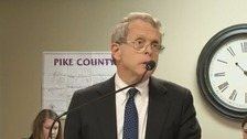 Attorney General Mike DeWine said it was still unclear who had killed the family