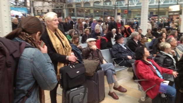 Passengers wait to board trains and head south from London Paddington.
