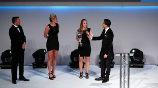 Sunderland Ladies' Beth Mead (second right) is interviewed by host Manish Bhasin after winning the PFA Young Women's Player of the Year Award during the PFA Awards at the Grosvenor House Hotel, London.