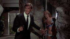 "Roger Moore and Britt Ekland in ""The Man With The Golden Gun""."