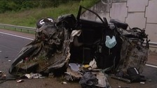 The mangled wreckage of the car