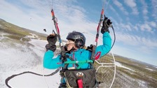 Sacha Dench flying her paramotor. She faces freezing temperatures.