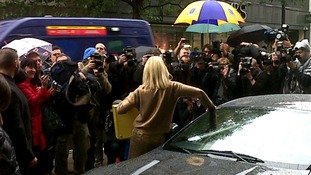 Britt Ekland shows photographers the golden briefcase carrying the Bond 50 Blu-ray Collection