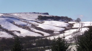 Stanage Edge in Derbyshire Peak District covered in snow