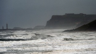 White capped waves at Whitby today as torrential rain and gale force winds sweep across much of the UK.