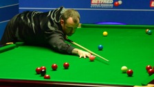 Mark Williams at the table in his match against Ding Junhui .
