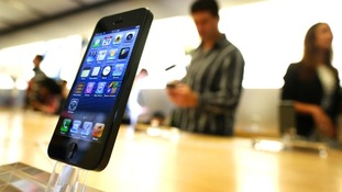An iPhone 5 is displayed in an Apple store in central Sydney shortly after going on sale to the public on Friday
