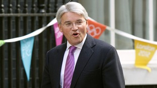 Andrew Mitchell arriving at No 10 Downing Street in central London.