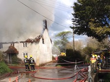 Ten fire engines tackled a fire at a thatched house in Dorset earlier.