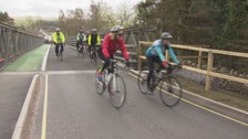 The cyclists are raising money for flood victims.
