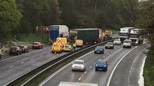 A lorry jack-knifed and hit the central reservation, catching fire
