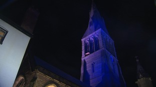 A tower lit up in blue