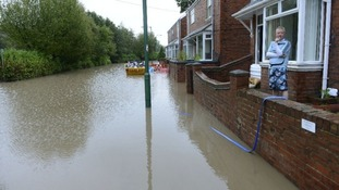 Residents look on in Chester-Le-Street as water levels rise.