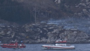 Smoke billows from the site of the crash