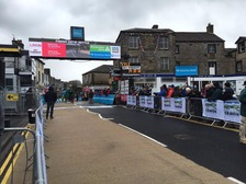 A crowd has gathered at the finish line in Settle, ready for the end of the first day of the Tour de Yorkshire 2016!