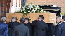 David Gest's coffin is carried into the crematorium