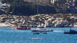 Rescuers work at a site where a helicopter has crashed, west of the Norwegian city of Bergen.