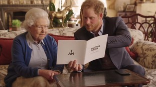 The Queen and Prince Harry in the video on Twitter.
