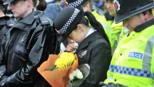 Family of PCs Fiona Bone and Nicola Hughes join their colleagues for vigil and minute's silence