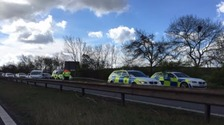 Police at the scene of a crash on the A1(M) in South Yorkshire