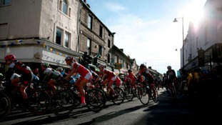 Riders cross the start line during stage two of the Tour de Yorkshire.