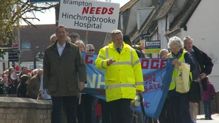 Protest march over plans to merge two Cambridgeshire hospitals