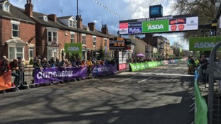 Crowds line streets waiting at finish line in Doncaster