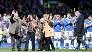 Families of the Hillsborough victims on the pitch before the Barclays Premier League match at Goodison Park.