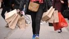 A shopper carrying shopping bags on Oxford Street in London.