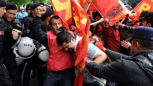 Turkish riot police scuffle with protesters as they attempted to defy a ban and march on Taksim Square to celebrate May Day, Istanbul.