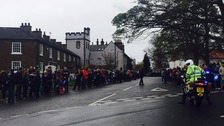 The crowds line the street through Hutton Rudby