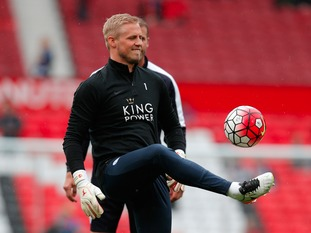 Keeper Kasper Schmeichel warms up during at Old Trafford.