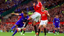 Leicester City's Leonardo Ulloa shoots under pressure from Manchester United's Chris Smalling