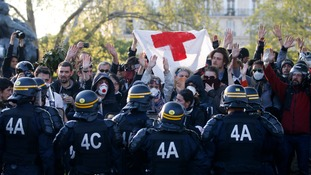 Riot police and protesters face off at the Place de la Nation
